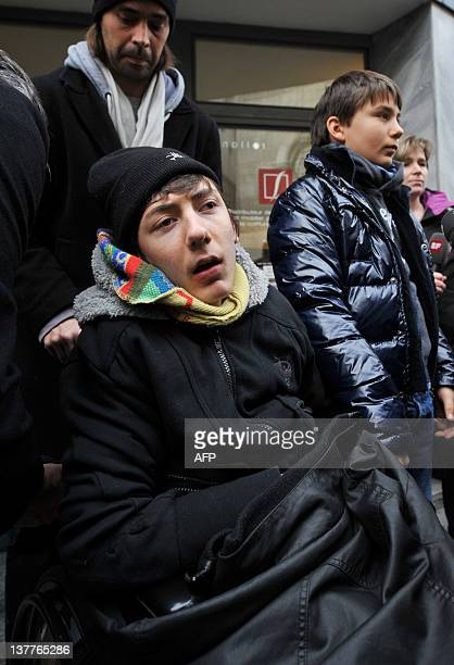 Quadriplegic 16yearold Italian boy Luca Mongelli and brother Marco protest on January 26 2011 near the palace of justice in Sion In 2002 Luca was...