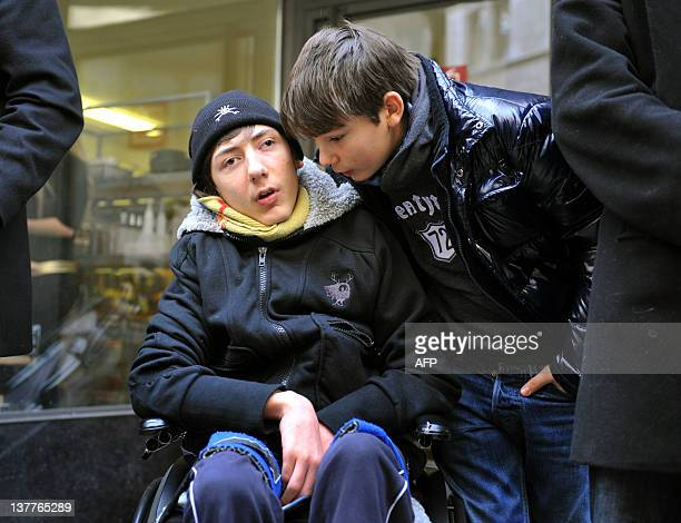 Quadriplegic 16yearold Italian boy Luca Mongelli and his brother Marco protest on January 26 2011 near the palace of justice in Sion In 2002 Luca was...