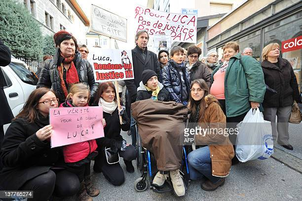 Quadriplegic 16yearold Italian boy Luca Mongelli his mother Tina and brother Marco protest on January 26 2011 near the palace of justice in Sion In...