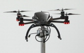 A quadrocopter drone equipped with a camera stands on display at the Zeiss stand on the first day of the CeBIT 2012 technology trade fair on March 6...