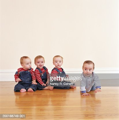 Quadruplet stock photos and pictures getty images for Hardwood floors and babies