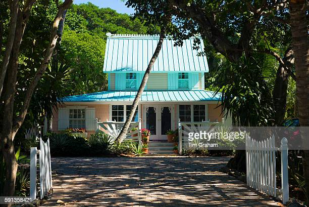 Quaint clapboard winter cottage home with sundeck and palm trees on Captiva Island in Florida USA