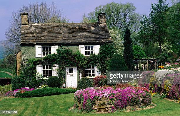 Quaint garden with rustic house, Edensor, United Kingdom