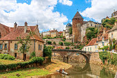 Quaint river through the medieval town of Semur en Auxois, Burgundy, France