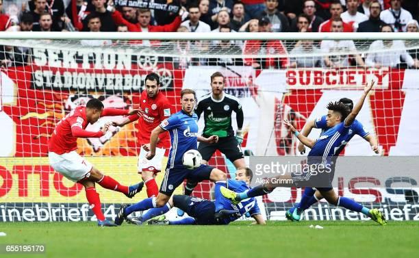 R Quaison of FSV Mainz 05 ihas a shot at goal blocked during the Bundesliga match between 1 FSV Mainz 05 and FC Schalke 04 at Opel Arena on March 19...