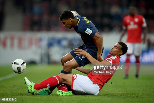 Quaison of Mainz and Da Silva Fernandes of Leipzig battle for the ball during the Bundesliga match between 1 FSV Mainz 05 and RB Leipzig at Opel...