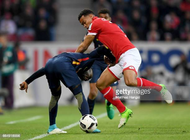 Quaison of Mainz and Naby Deco Keita of Leipzig battle for the ball during the Bundesliga match between 1 FSV Mainz 05 and RB Leipzig at Opel Arena...