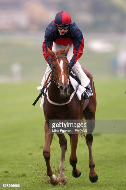 Quaker Parrot ridden by Richard Kingscote going to post for the Abbey Park Handicap