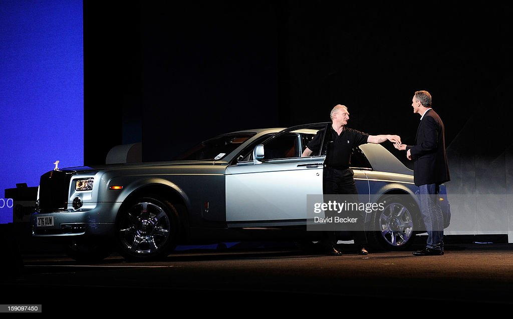 Qualcomm Inc., Chairman and CEO Dr. Paul E. Jacobs (R) receives the keys to an all electric Rolls Royce during a keynote address at the 2013 International CES at The Venetian on January 7, 2013 in Las Vegas, Nevada. CES, the world's largest annual consumer technology trade show, runs from January 8-11 and is expected to feature 3,100 exhibitors showing off their latest products and services to about 150,000 attendees.