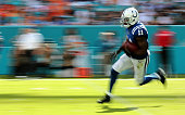 Quan Bray of the Indianapolis Colts returns a kick during a game against the Miami Dolphins at Sun Life Stadium on December 27 2015 in Miami Gardens...