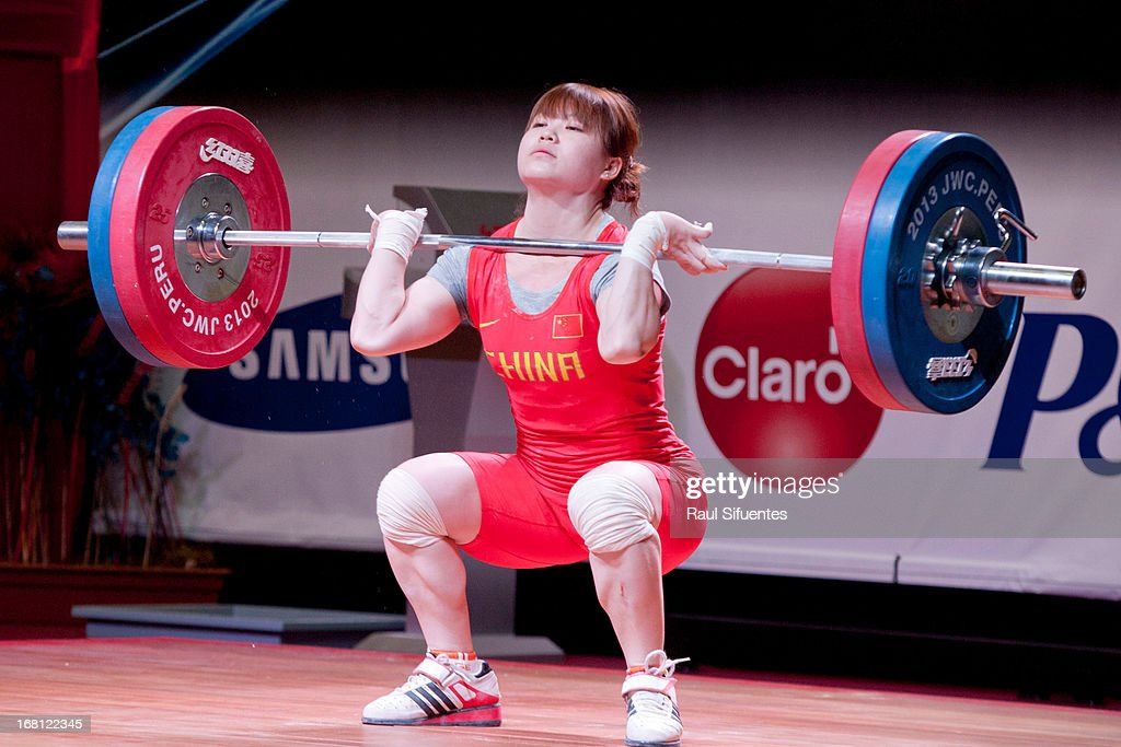 Quan Li of China A competes in the Women's 53kg clean and jerk during day two of the 2013 Junior Weightlifting World Championship at Maria Angola...