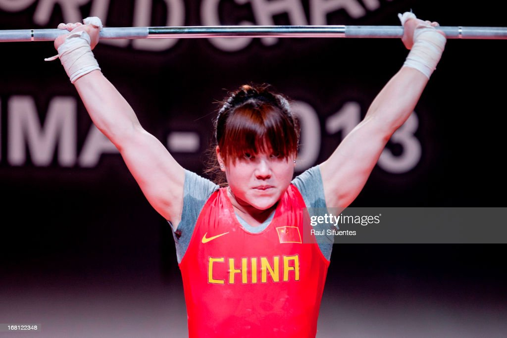 Quan Li of China A competes in the Women's 53kg clean and jerk during day two of the 2013 Junior Weightlifting World Championship at Maria Angola Convention Center on April 05, 2013 in Lima, Peru.