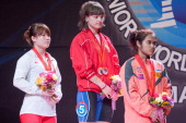 Quan Liu of China A Alena Chychkan of Belarus A and Sopita Tanasan of Thailand A stand on the podium of Total Women's 53kg during day two of the 2013...