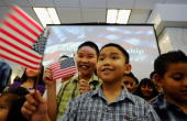 Quang Vo from Vietnam celebrates his citizenship with his brother Minh during a citizenship ceremony August 19 2010 in Los Angeles California During...