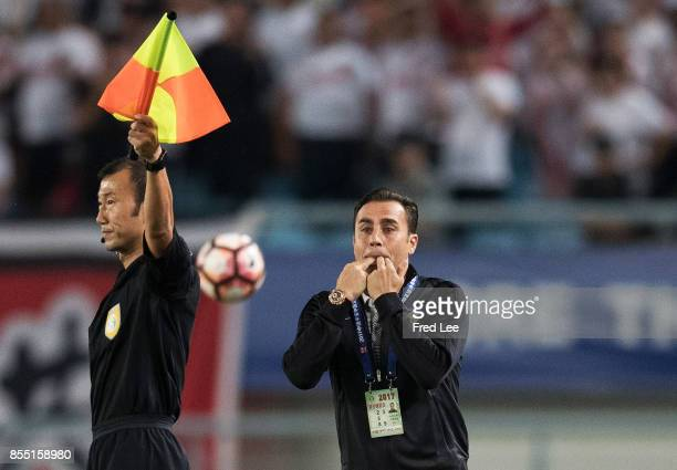 Quanjian FC head coach Fabio Cannavaro reacts prior to the China Super League match between Jiangsu FC and Tianjin Quanjian FC at Nanjing Olympic...