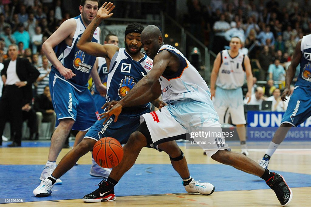 Quantez Robertson of Frankfurt and Louis Campbell of Bremerhaven fight for the ball during the Beko Basketball Bundesliga playoff match between...