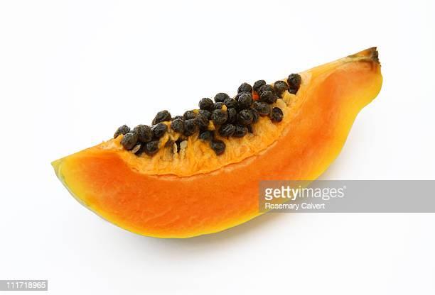 Quarater of a fresh, ripe papaya or paw paw.