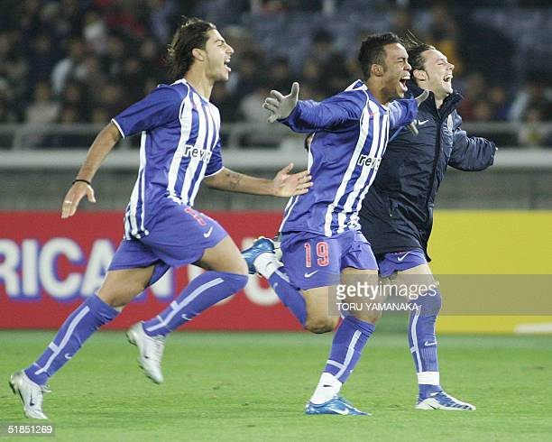 Quaresma Carlos Alberto and Maniche of Portugese club FC Porto run toward other teammates on the pitch to celebrate their victory when they defeat...