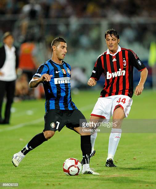 Quaresma of Internazionale and Massimo Oddo of AC Milan during the TIM Trophy at 'Adriatico' Stadium on August 14 2009 in Pescara Italy