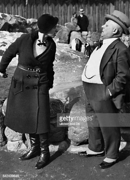 Quarreling couple resembling pengiuns at the Berlin Zoo 1932 Photographer Seidenstuecker Published by 'Berliner Illustrirte Zeitung' 13/1932 Vintage...
