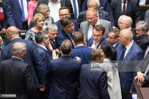 Quarrels and scuffles during a night debate on a Supreme Court bill in the lower house of Polish Parliament in Warsaw Poland on 18 July 2017