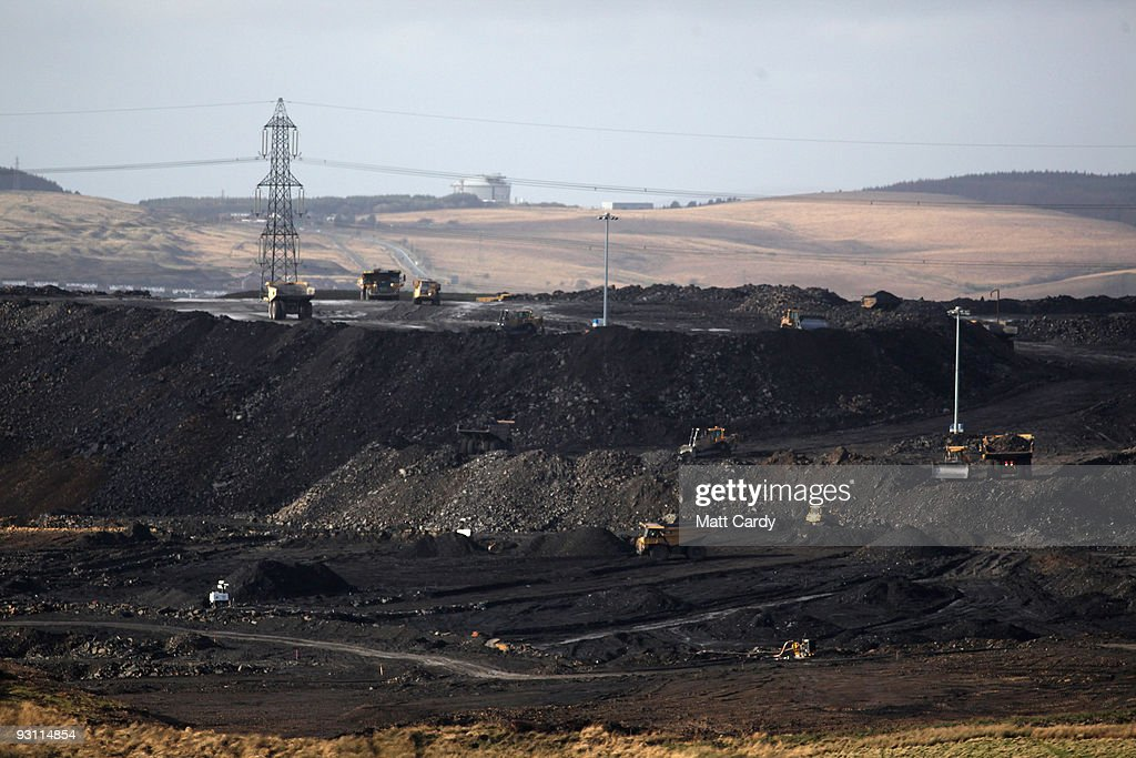 Quarry lorries move materials around the FfosYFran opencast coal mine on November 17 2009 in Merthyr Tydfil Wales As world leaders prepare to gather...