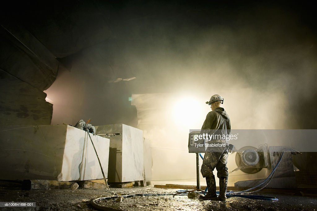 Quarryman operating wire saw in marble quarry : Stock Photo