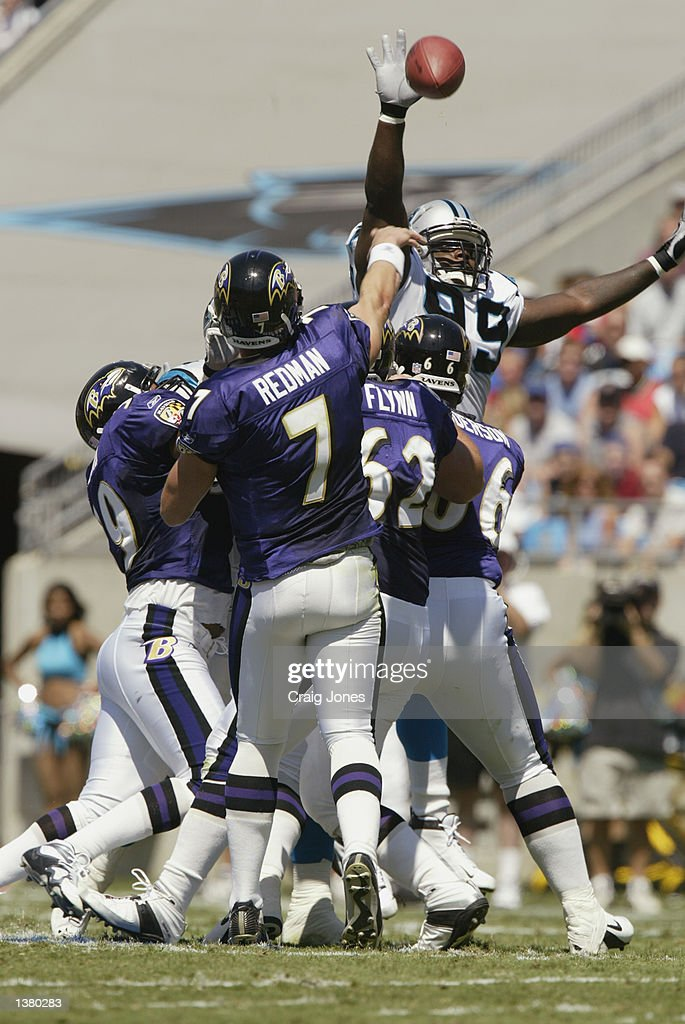 Quarteback Chris Redman #7 of the Baltimore Ravens passes the ball as it is blocked by Bretnson Buckner #99 of the Carolina Panthers on September 8, 2002 at Ericsson Stadium in Charlotte, North Carolina. The Panthers defeated the Ravens 10-7.
