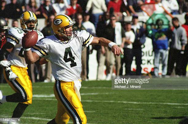 Quarter Back Brett Favre of the Green Bay Packers passes to an open receiver in a NFL game against the Tampa Bay Buccaneers at Tampa Stadium on...