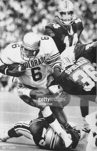 Quarter back Mark Hatcher gets nabbed by Ohio linebacker Chris Spielman as he tries to get up field on an option run Credit Denver Post