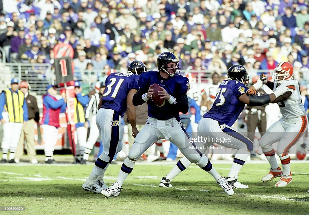 Quarter Back Trent Dilfer #8 of the Baltimore Ravens drops back to pass with his teammate Jonathan Ogden #75 blocking a rusher in a NFL game against the Cleveland Browns at PSINet Ravens Stadium on November 26, 2000 in Baltimore, Maryland. The Ravens defeated the Browns 44 to 7.