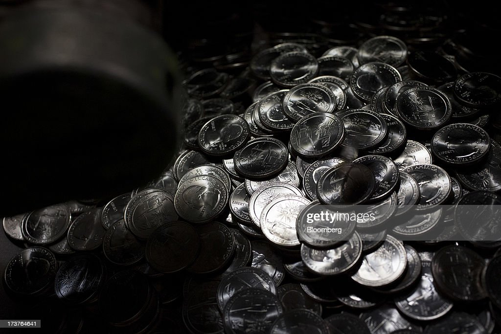 U.S. quarter dollar coins sit in a bin after being pressed at the U.S. Mint in Philadelphia, Pennsylvania, U.S., on Wednesday, July 17, 2013. Some sources of declining inflation 'are likely to be transitory' and expectations for future price increases 'have generally remained stable,' Ben S. Bernanke, chairman of the U.S. Federal Reserve said in prepared remarks. Photographer: Scott Eells/Bloomberg via Getty Images