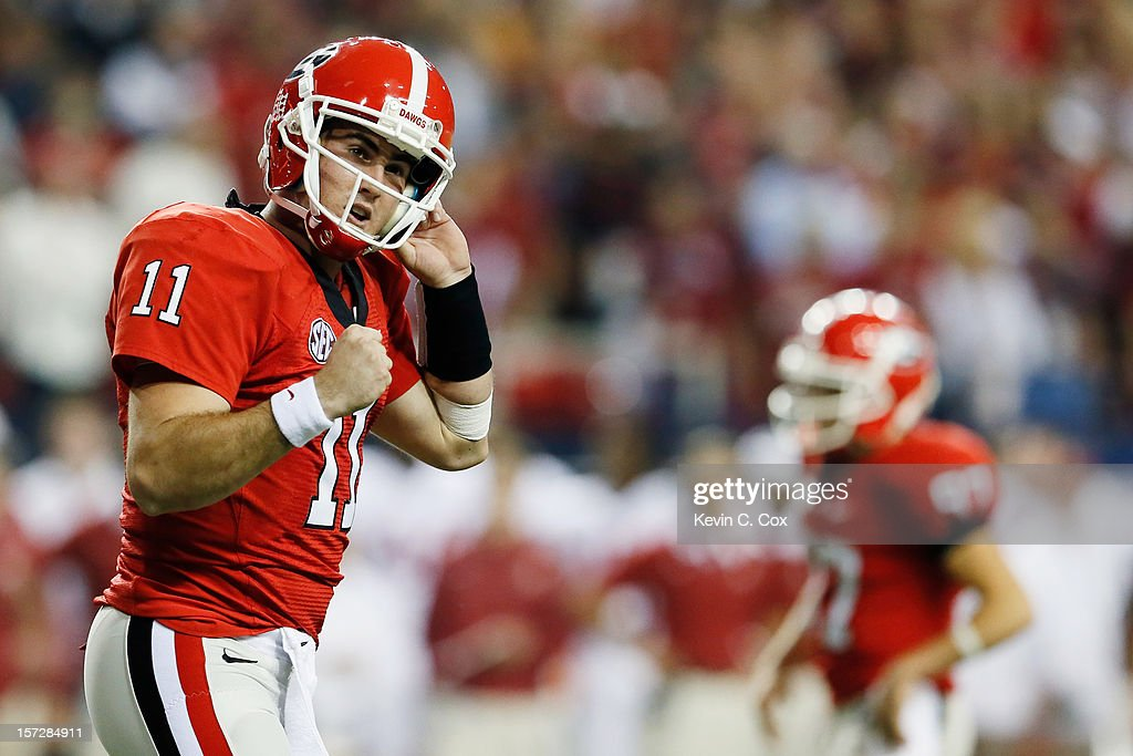 Quarterback Aaron Murray #11 of the Georgia Bulldogs celebrates after the Bulldogs scored a third quarter touchdown against the Alabama Crimson Tide during the SEC Championship Game at the Georgia Dome on December 1, 2012 in Atlanta, Georgia.