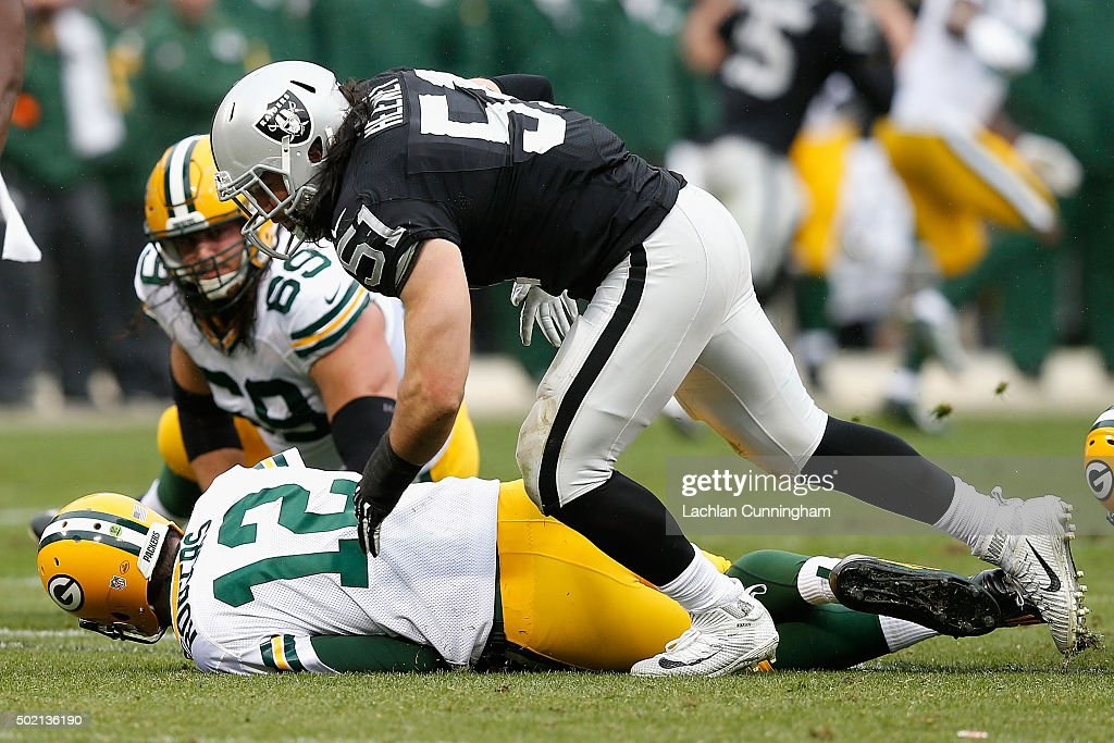 Quarterback Aaron Rodger #12 of the Green Bay Packers is sacked by Line Backer Ben Heaney #51 of the Oakland Raiders in the second quarter at O.co Coliseum on December 20, 2015 in Oakland, California.