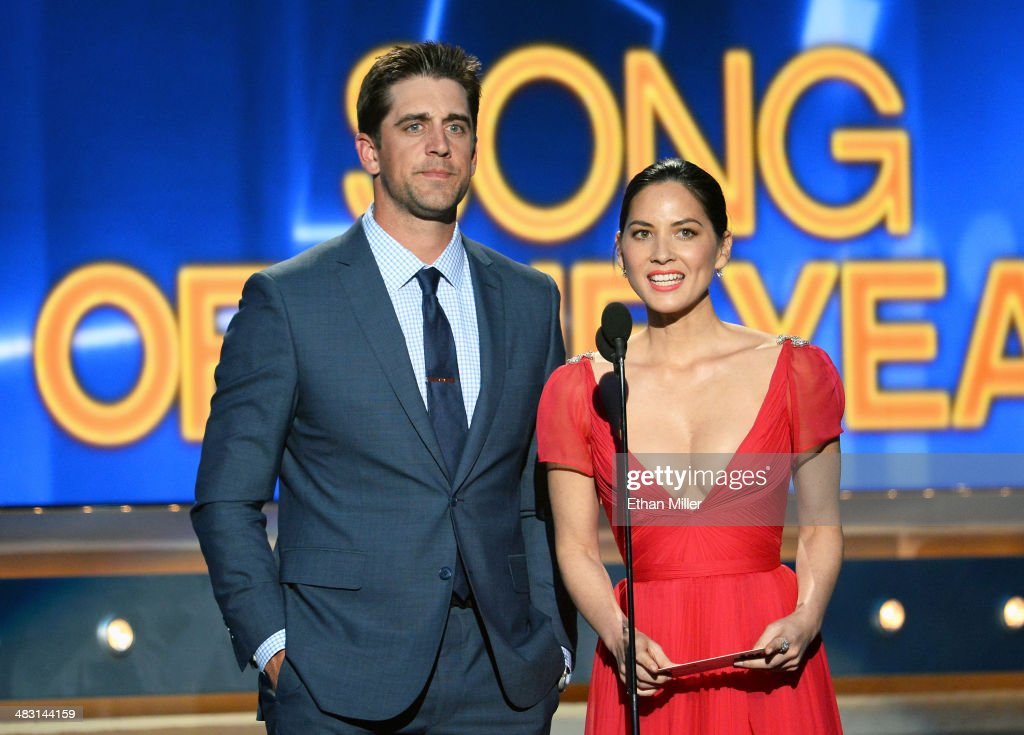 NFL quarterback Aaron Rodgers (L) and actress Olivia Munn speak onstage during the 49th Annual Academy of Country Music Awards at the MGM Grand Garden Arena on April 6, 2014 in Las Vegas, Nevada.