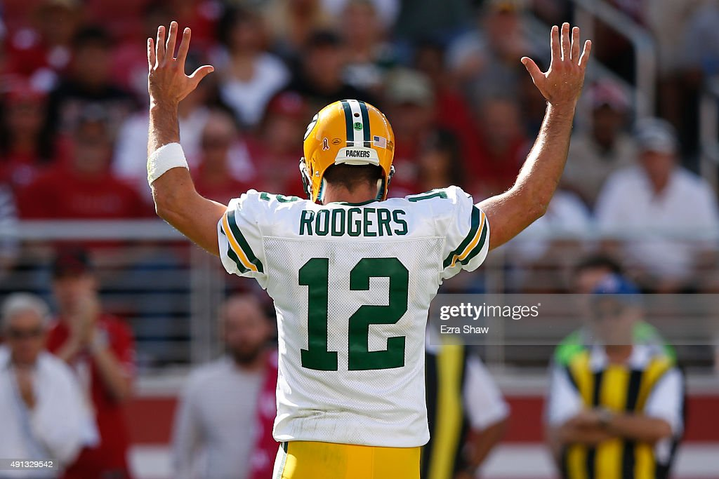 quarterback Aaron Rodgers #12 of the Green Bay Packers celebrates after a John Kuhn #30 (not pictured) touchdown against the San Francisco 49ers during their NFL game at Levi's Stadium on October 4, 2015 in Santa Clara, California.