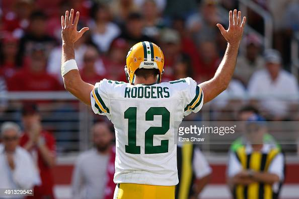quarterback Aaron Rodgers of the Green Bay Packers celebrates after a John Kuhn touchdown against the San Francisco 49ers during their NFL game at...