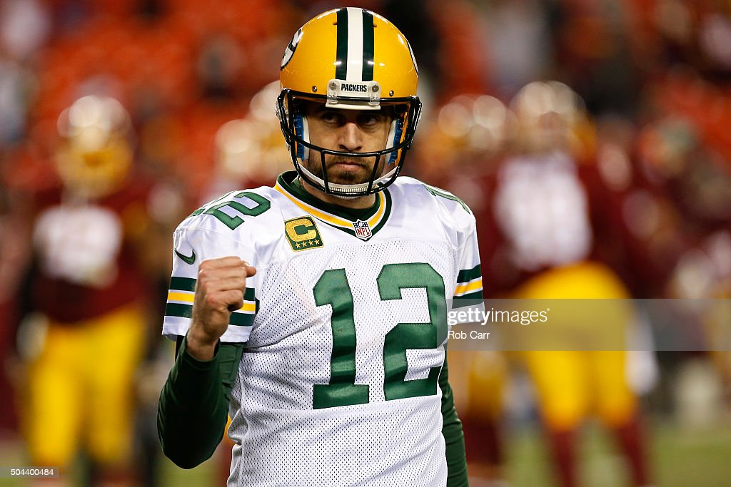 Quarterback <a gi-track='captionPersonalityLinkClicked' href=/galleries/search?phrase=Aaron+Rodgers+-+Joueur+de+football+am%C3%A9ricain+-+Quarterback&family=editorial&specificpeople=215257 ng-click='$event.stopPropagation()'>Aaron Rodgers</a> #12 of the Green Bay Packers celebrates after the Green Bay Packers defeated the Washington Redskins 35-18 during the NFC Wild Card Playoff game at FedExField on January 10, 2016 in Landover, Maryland.