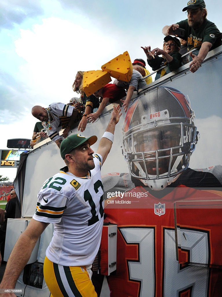 Quarterback Aaron Rodgers #12 of the Green Bay Packers high fives fans as he leaves the field against the Tampa Bay Buccaneers at Raymond James Stadium on December 21, 2014 in Tampa, Florida.