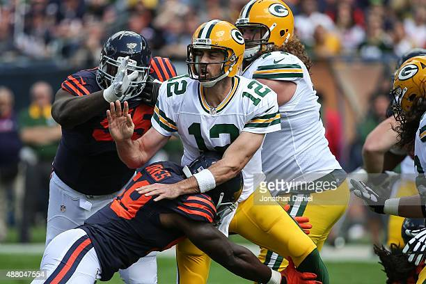 Quarterback Aaron Rodgers of the Green Bay Packers is hit by Christian Jones of the Chicago Bears in the first quarter at Soldier Field on September...