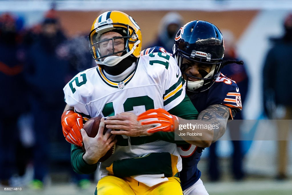 Quarterback Aaron Rodgers #12 of the Green Bay Packers is sacked by John Timu #53 of the Chicago Bears in the fourth quarter at Soldier Field on December 18, 2016 in Chicago, Illinois. The Green Bay Packers defeated the Chicago Bears 30-27.