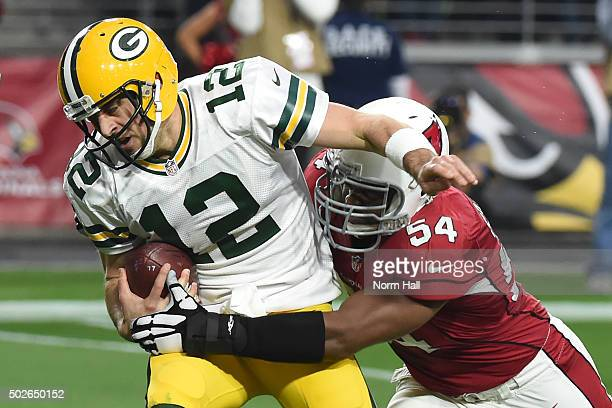 Quarterback Aaron Rodgers of the Green Bay Packers is sacked by linebacker Dwight Freeney of the Arizona Cardinals in the third quarter of the NFL...