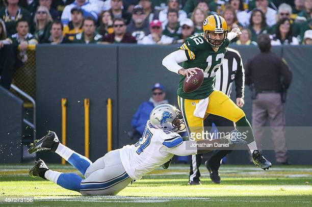 Quarterback Aaron Rodgers of the Green Bay Packers is sacked by Caraun Reid of the Detroit Lions in the first quarter at Lambeau Field on November 15...