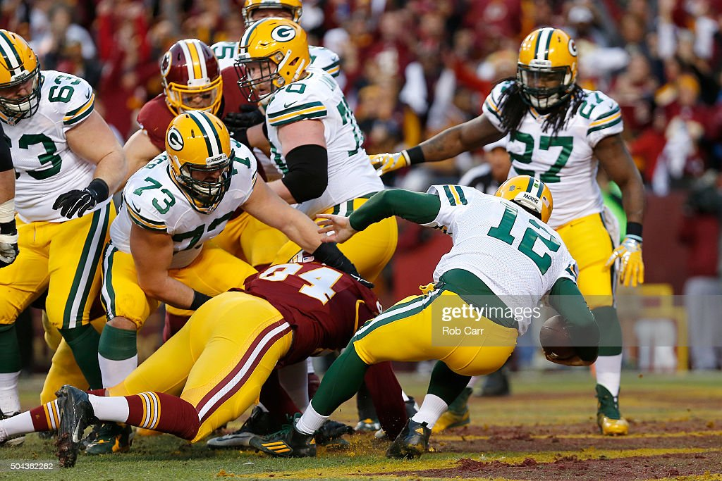 Quarterback Aaron Rodgers #12 of the Green Bay Packers is sacked for a safety by defensive end Preston Smith #94 of the Washington Redskins in the first quarter during the NFC Wild Card Playoff game at FedExField on January 10, 2016 in Landover, Maryland.