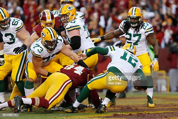Quarterback Aaron Rodgers of the Green Bay Packers is sacked for a safety by defensive end Preston Smith of the Washington Redskins in the first...