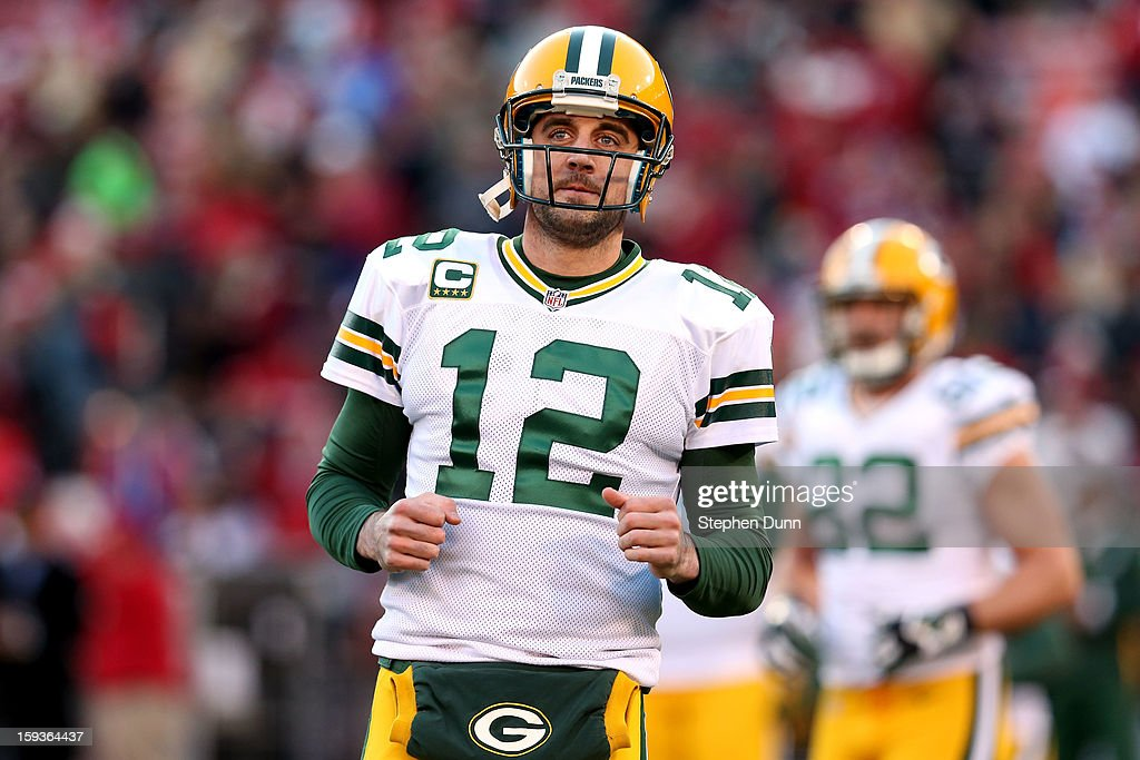 Quarterback Aaron Rodgers #12 of the Green Bay Packers looks on during warm ups prior to the NFC Divisional Playoff Game against the San Francisco 49ers at Candlestick Park on January 12, 2013 in San Francisco, California.