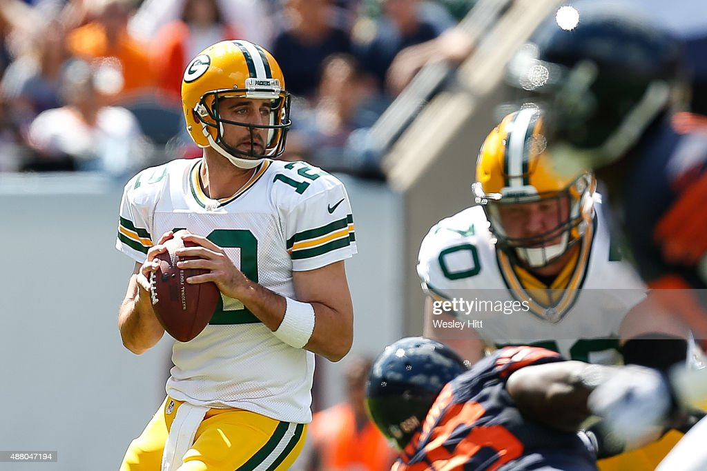 Quarterback <a gi-track='captionPersonalityLinkClicked' href=/galleries/search?phrase=Aaron+Rodgers+-+American+Football+Quarterback&family=editorial&specificpeople=215257 ng-click='$event.stopPropagation()'>Aaron Rodgers</a> #12 of the Green Bay Packers looks to pass in the first quarter against the Chicago Bears at Soldier Field on September 13, 2015 in Chicago, Illinois.