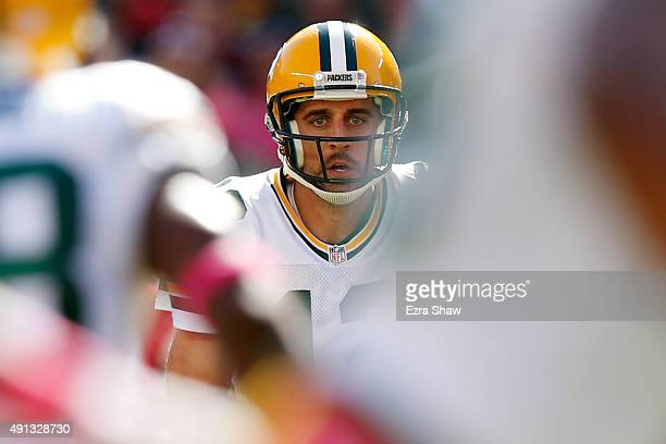 Quarterback Aaron Rodgers of the Green Bay Packers looks to throw a pass against the San Francisco 49ers during their NFL game at Levi's Stadium on...