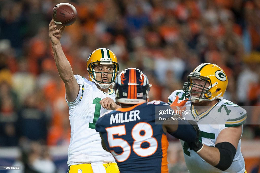 Quarterback <a gi-track='captionPersonalityLinkClicked' href=/galleries/search?phrase=Aaron+Rodgers+-+Quarterback+de+futebol+americano&family=editorial&specificpeople=215257 ng-click='$event.stopPropagation()'>Aaron Rodgers</a> #12 of the Green Bay Packers passes against the Denver Broncos at Sports Authority Field at Mile High on November 1, 2015 in Denver, Colorado.