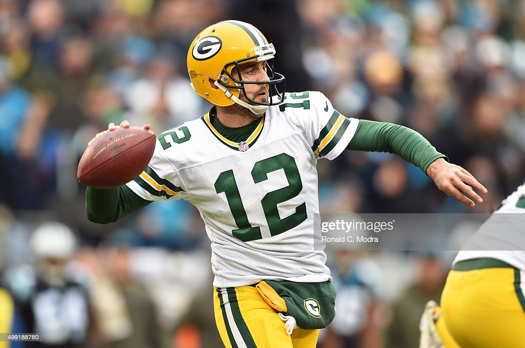 Quarterback <a gi-track='captionPersonalityLinkClicked' href=/galleries/search?phrase=Aaron+Rodgers+-+Quarterback+de+futebol+americano&family=editorial&specificpeople=215257 ng-click='$event.stopPropagation()'>Aaron Rodgers</a> #12 of the Green Bay Packers passes during a NFL game against the Carolina Panthers at Bank Of America Stadium on November 8, 2015 in Charlotte, North Carolina.